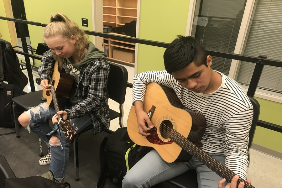 Felix Zarate and Madison Riley practice guitar in Mr. Lloyd's third period class.