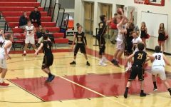 Boys basketball season starts with wins against South Carroll: Photo of the Day