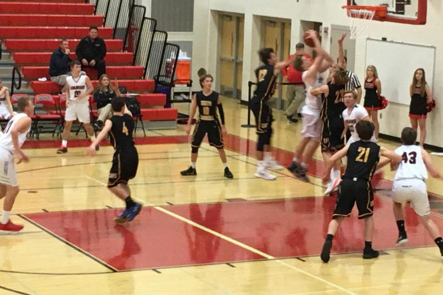 Graeson Ruch powers his way into the paint and goes up for a layup.