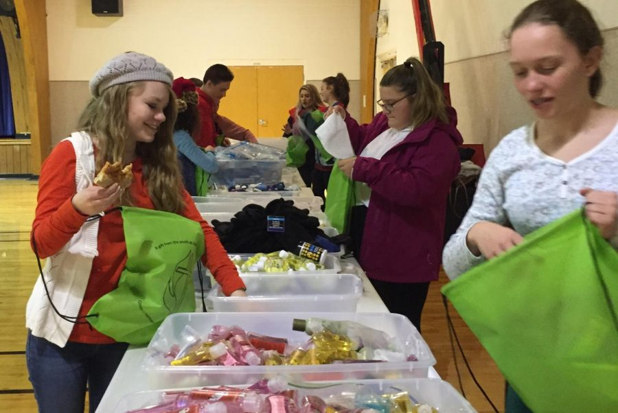 Eighth+graders+Emily+Watson+%28right%29+and+Christina+Damato+%28left%29+assemble+blessing+bags.