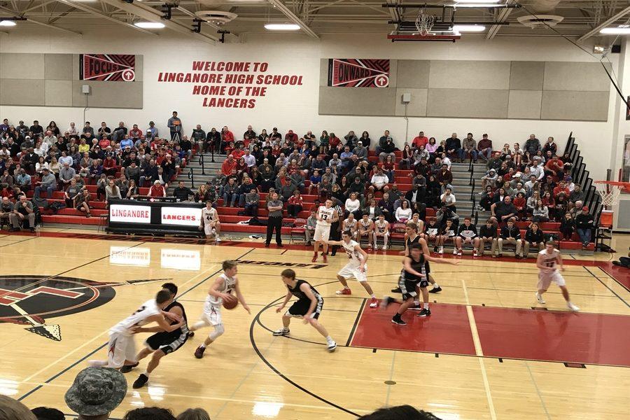 Christian Nolan makes a break for the basket