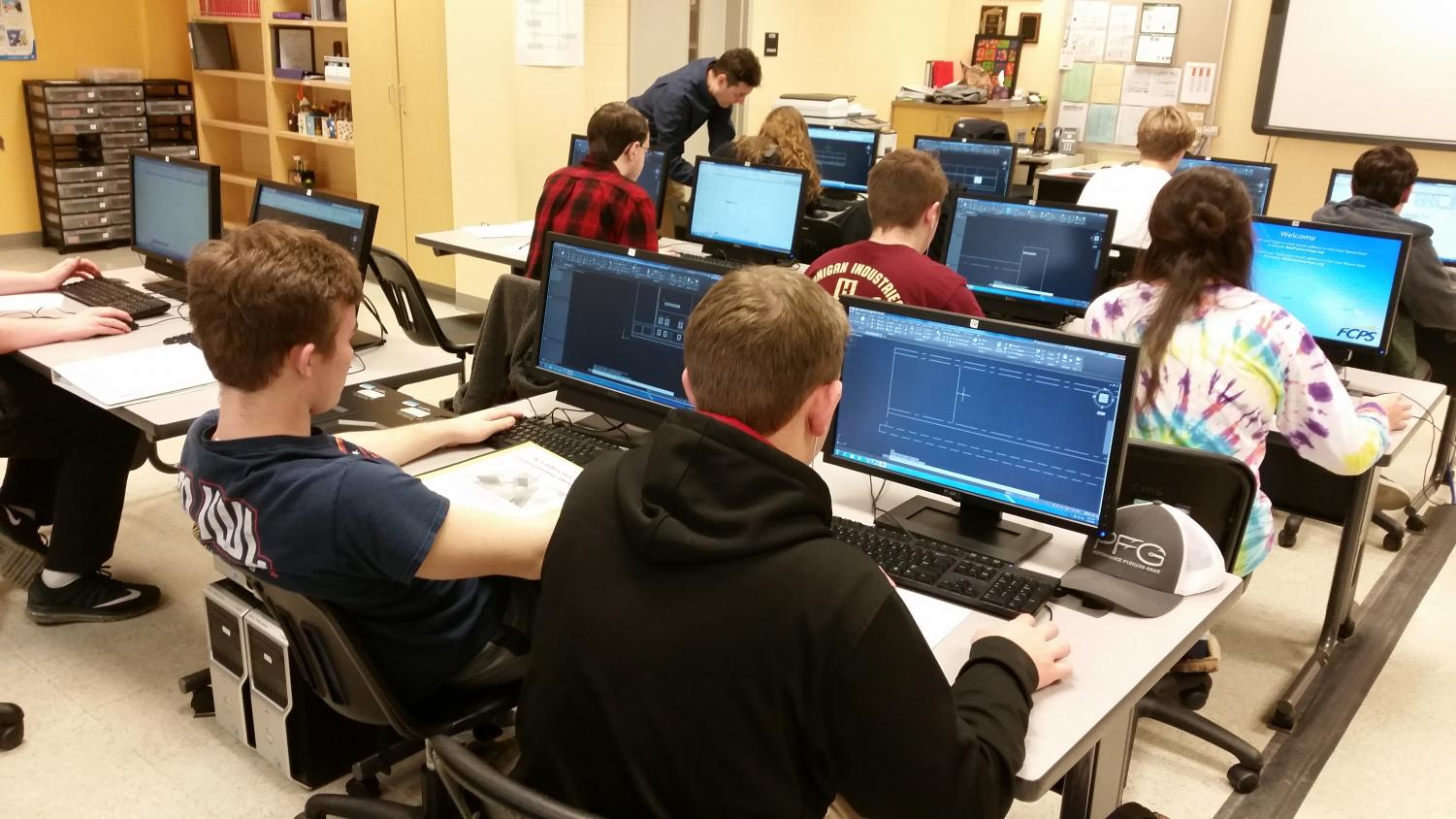 Lastova's AED 1 class works on their final projects.