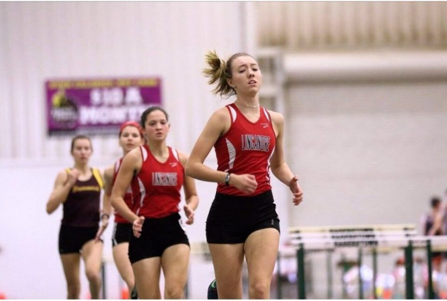 Khelsa Connolly, Alanah Follis, and Emily Wolfe compete in the 500 Meter dash.