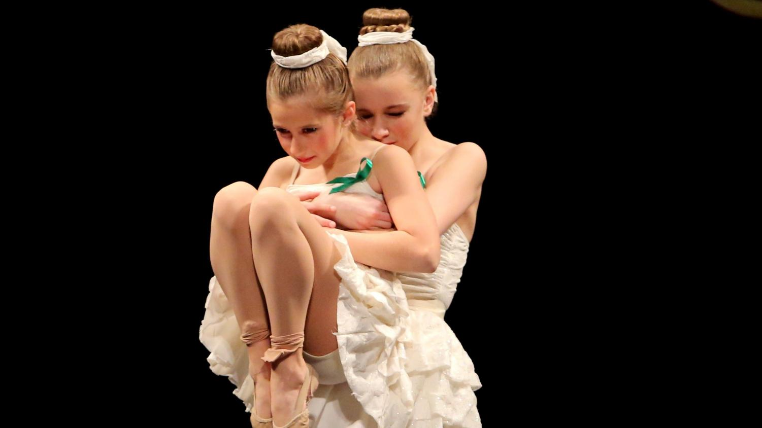 Authors Ashley Nash and Kelsey Ward dance at a competition.