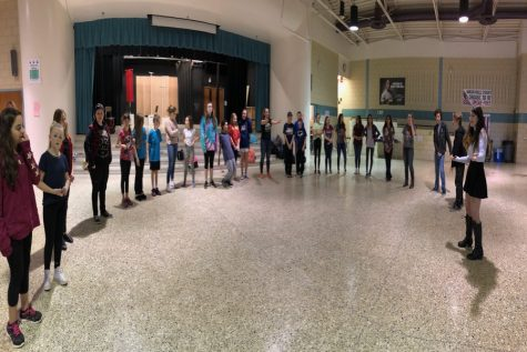 Linganore drama students teach middle school students improv games.
