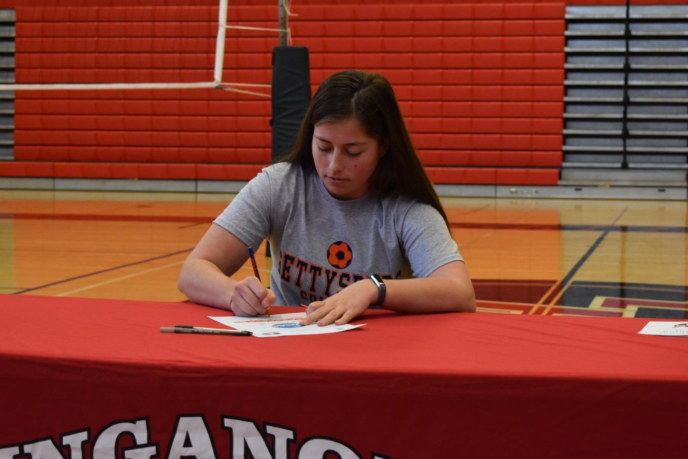 Maddie Cunningham signs her National Letter of Intent to Gettysburg College.