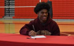 All smiles for Zamare as he signs his National Letter of Intent.