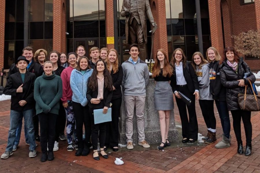 Mock+trial+team+stands+in+front+of+the+Frederick+County+Courthouse.