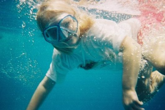A photo from the early 2000's, Lilly swims under water in Puerto Rico.