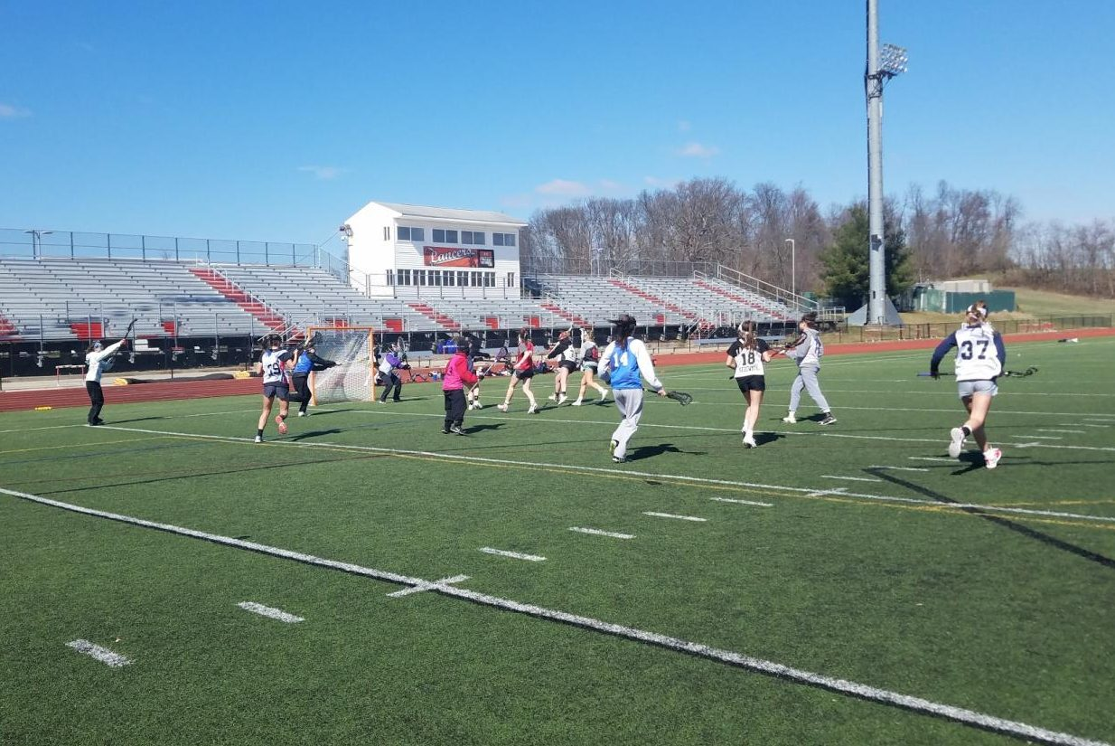 Varsity lacrosse scrimmages at the end of tryouts day two.