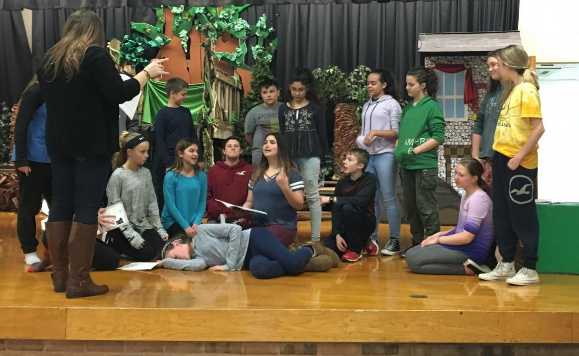 Students rehearse blocking for a scene in which Wendy is asleep, under the direction of Ms. Heeley