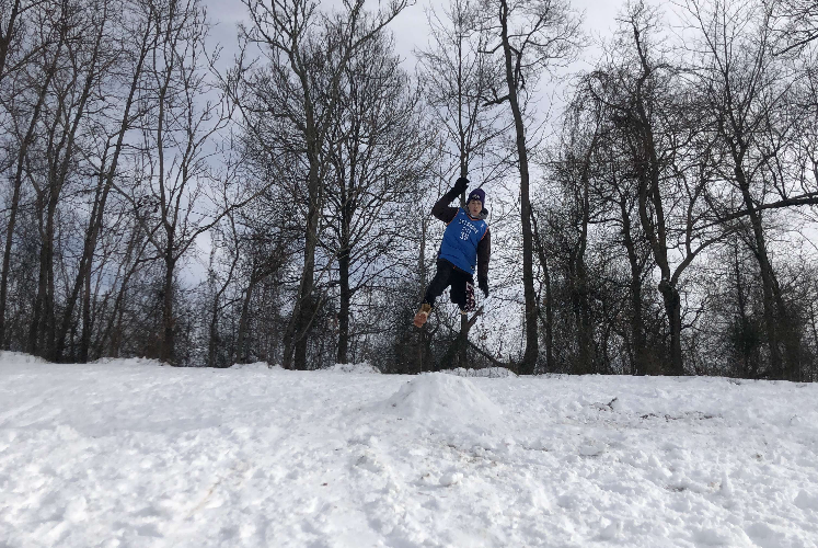 Braden Weinel jumps down the hill at Twin Ridge Elementary.