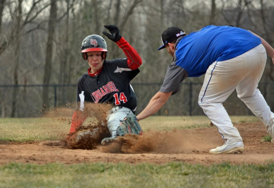 Dylan+Miller+slides+into+home+plate+to+avoid+a+tag.