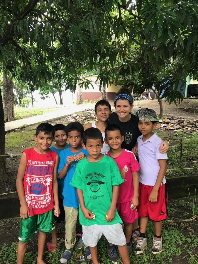Emily Wolfe with orphans in Nicaragua.