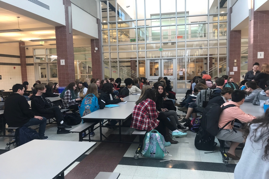 Students gather in a peaceful protest inside the cafeteria