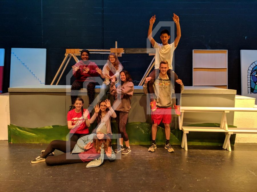 Seniors Ronin Tecle, Allie Hudson, Alanah Follis, Alexander Tran, Carolyn Payne, Lily Tate, Kayli Wenttang, and Josh Watson pose on stage.