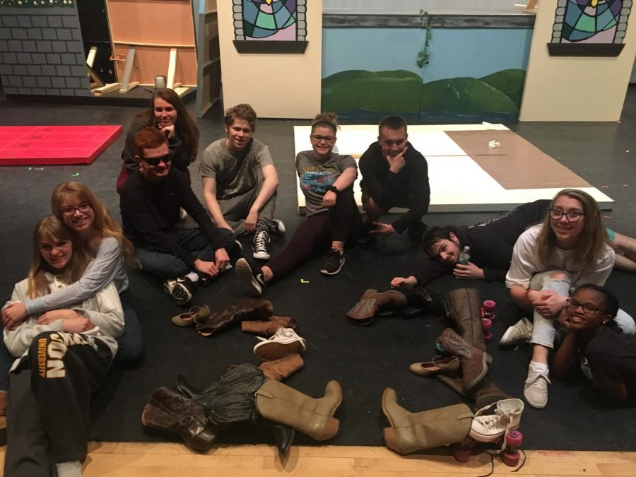 Drama department seniors gather around a variety of shoes featured in the spring musical, to celebrate 23 days until graduation.