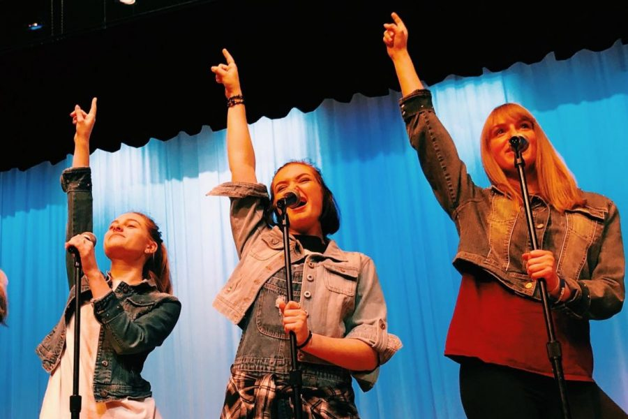 Macy Armagost, Presley Dougherty, and Samantha Buntman rehearse,