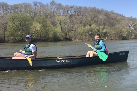 Sarah Hall and Hannah Lemen canoe down the Potomac River.