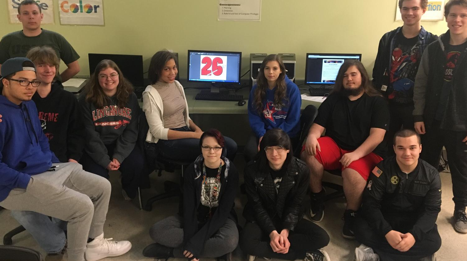 Computer graphics seniors pose in Mrs. Bozzonetti's class for day 26 of the senior countdown.
