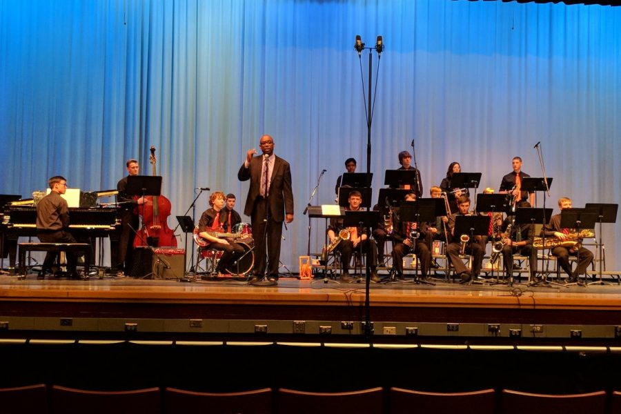 All-County+Jazz+Ensemble+director+Paul+Carr+addresses+the+audience+during+performance.