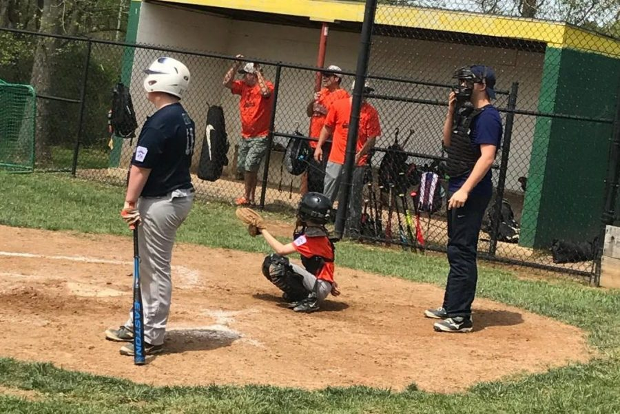 Coach+Matthew+Gelhard+steps+in+as+a+umpire+for+a+scrimmage.