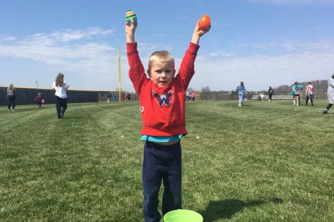 Grady stands triumphant with two of his many eggs.