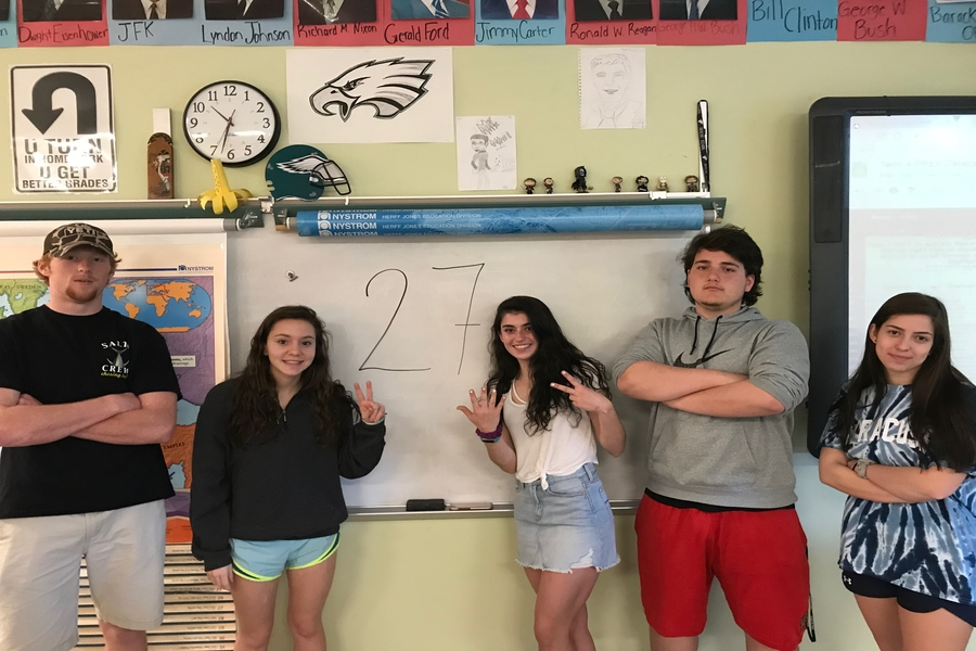 Seniors Tristan Drenner, Marie Tapscott, Adriana D'Amore, Joe Russo, and Abby Harbowski pose in Mr. Hines' room