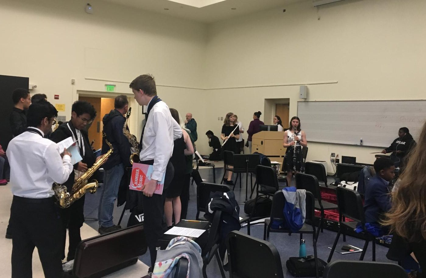 Students rehearse their pieces in the Towson warm up room before their performances.