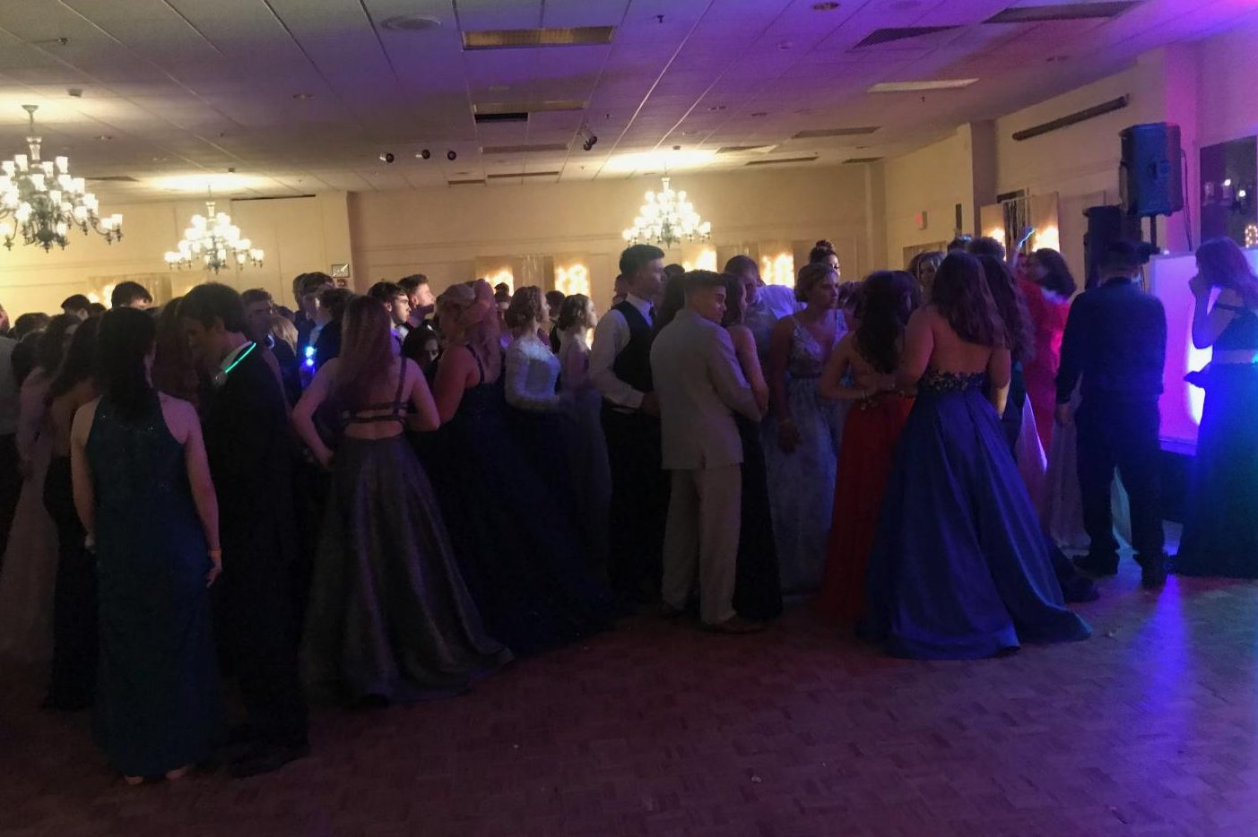 Students gathering around as Prom Queen and King are announced.