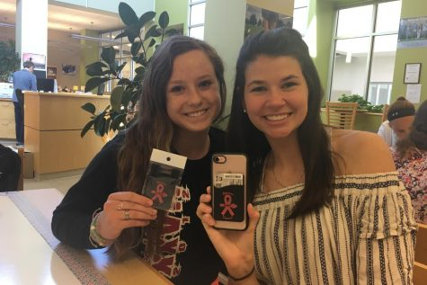 "SGA sells ""Lancer Against Cancer"" phone wallets: Photo of the Day 5/1/18"
