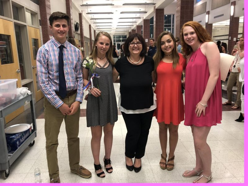 New inductees take a picture with Madame Blonder after the ceremony.