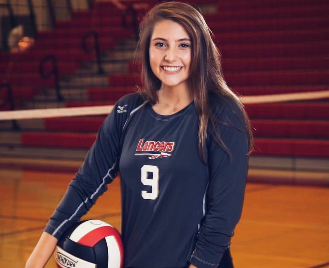 Mary Contardi poses for volleyball picture.
