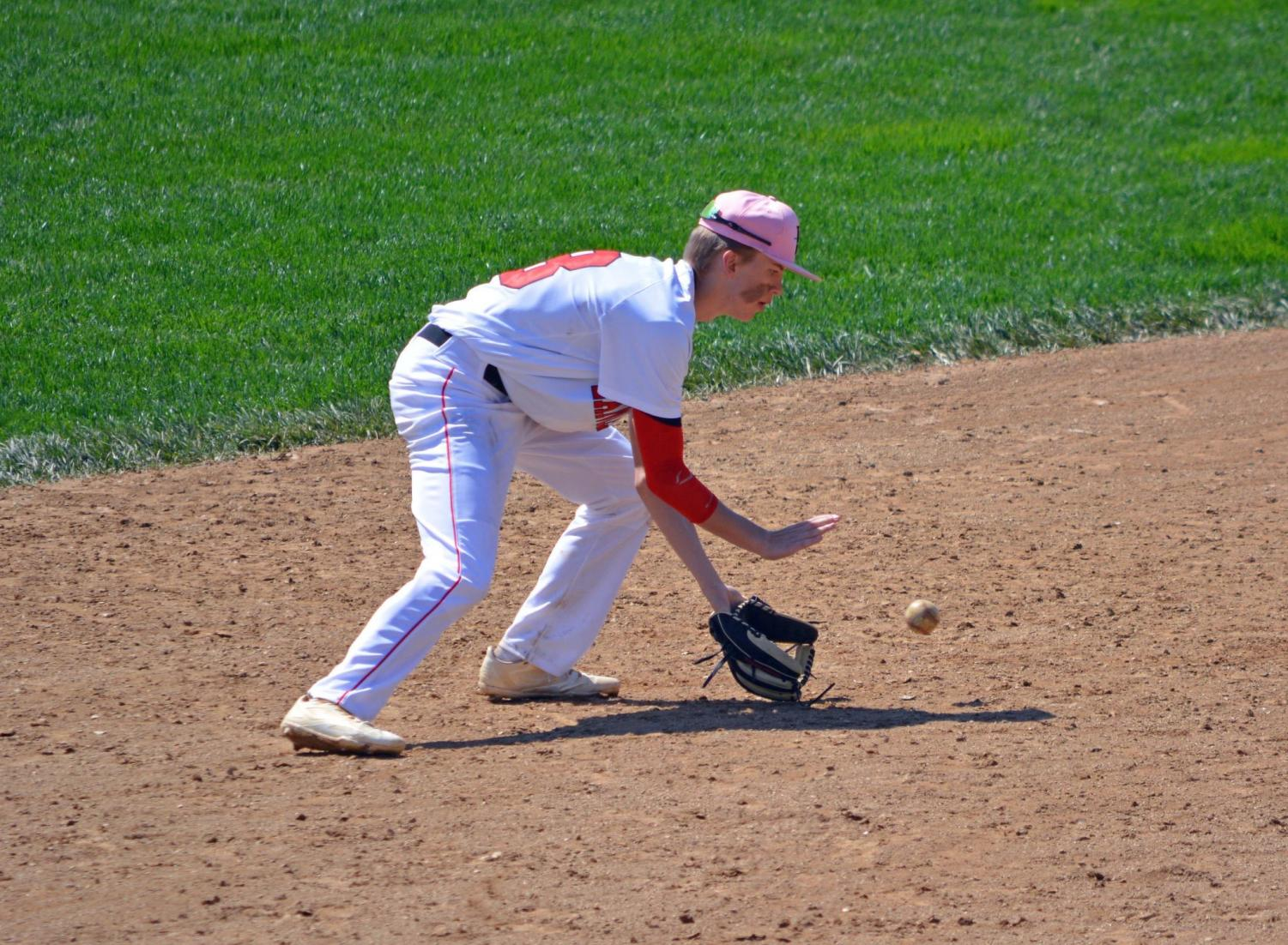 Schwartzbeck reaches for the ball.