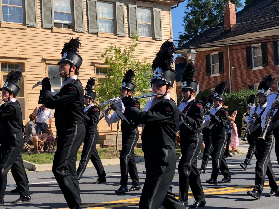 The band marches through the streets of New Market