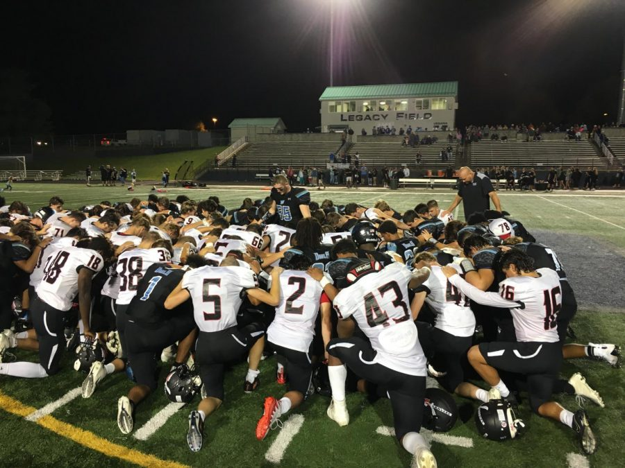 Linganore and Westminster unite at midfield for a postgame huddle.