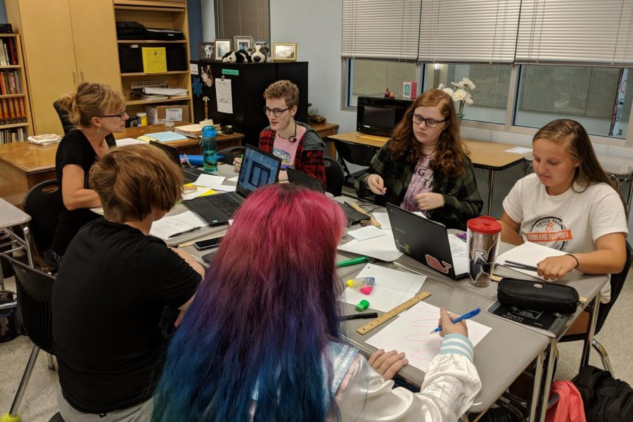Natalie Rebetsky, Mason Eddins, Katelyn Lynch, Alexis Keeling, Katie Lehman, and Beau Cameron work on their bullet journals.