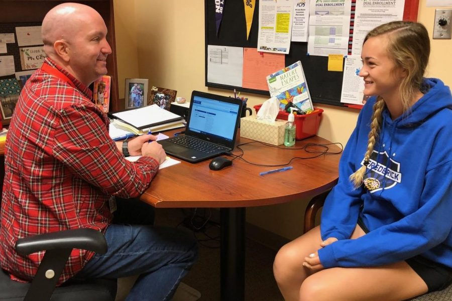 Counselor Mr. O'Brien helps student Karlee Duda.