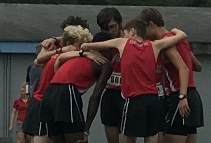 Micheal Belmaggio, Ben Dill, Carson Buck, Jack Sears, Will Cioffi and Bryce Witmer huddle together before race at Seahawk Invitational.