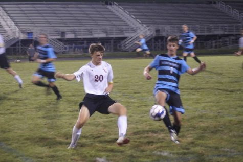Senior centre-back, Lukas Snyder goes in for a tackle against Westminster attacker
