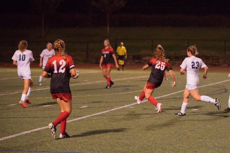 Brooke+Bennett+kicks+the+ball+against+Walkersville