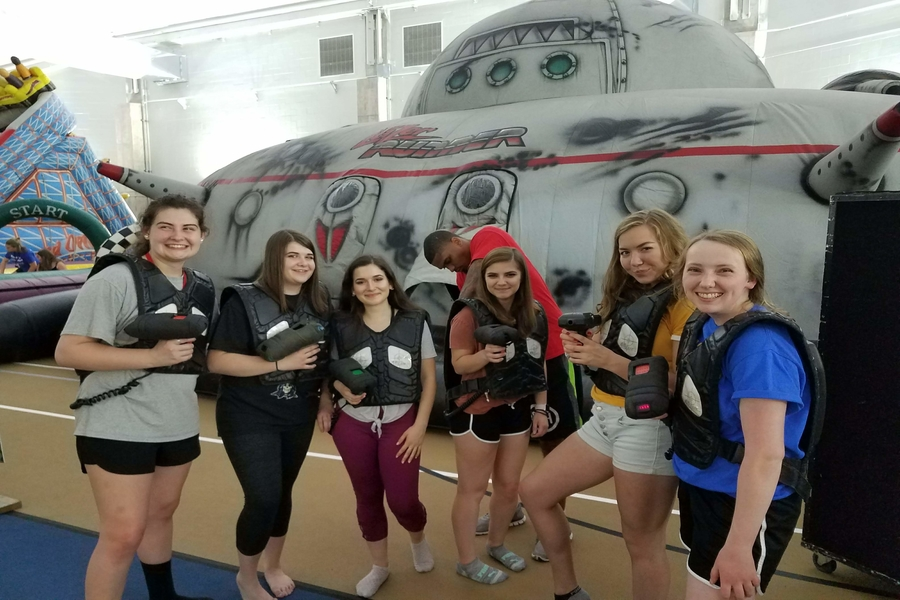 Recent graduates Rachael Moravansky, Olivia Hubble, Sophia Schuller, Sammie Volo, Shannon McGoey, and Mallory Safsten suit up for laser tag at Safe & Sane 2018.
