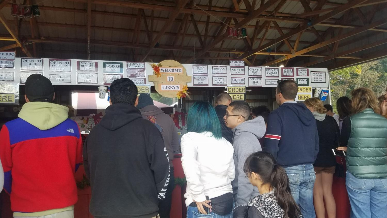 People line up at one of Butler's Orchard's food stands': Tubby's.