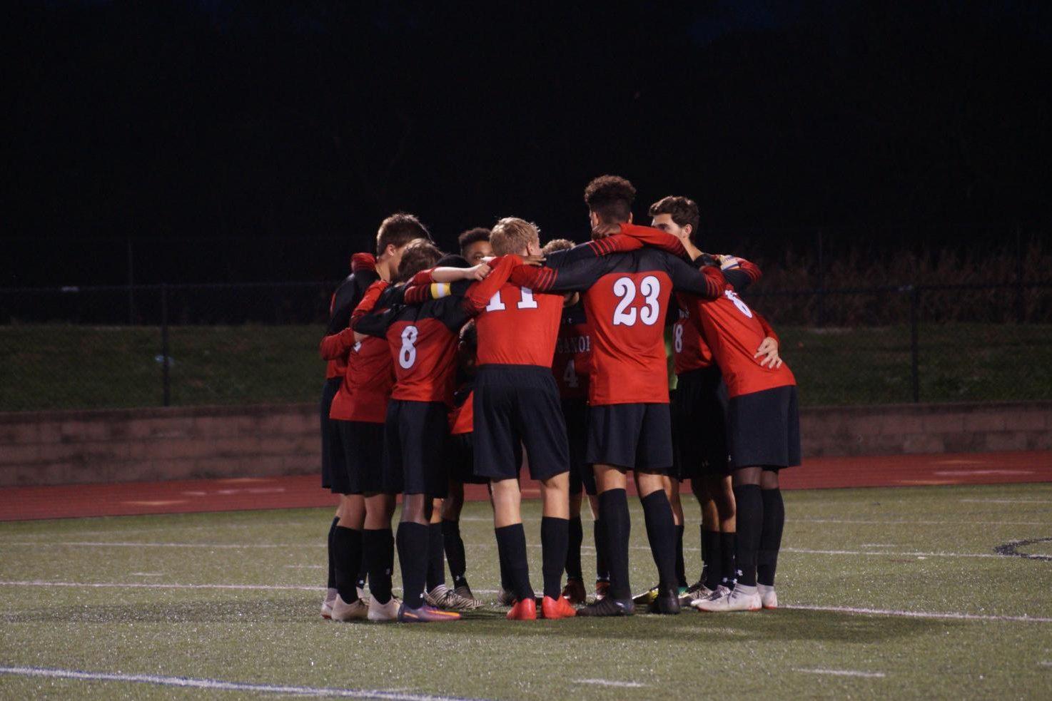 Boys starting lineup huddles  before taking on Tuscarora