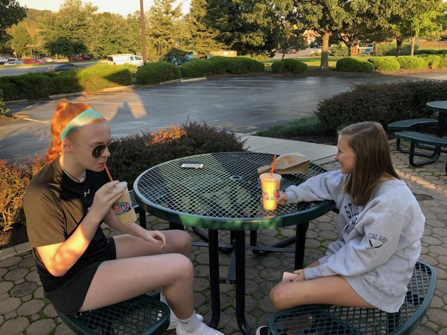 Valerie McNeill and Nataile Hartmark enjoy iced coffee on a sunny day.