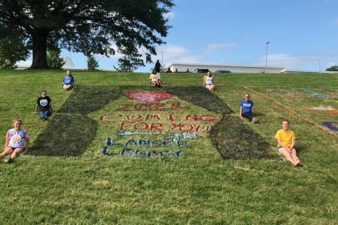 The class of 2022 surrounds their hill painting