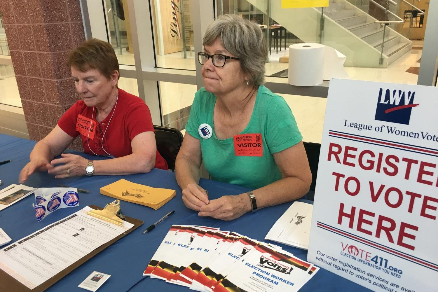 Mary Beth Coker and Betty Mayfield run the League of Women Voters registration table during lunch shifts.