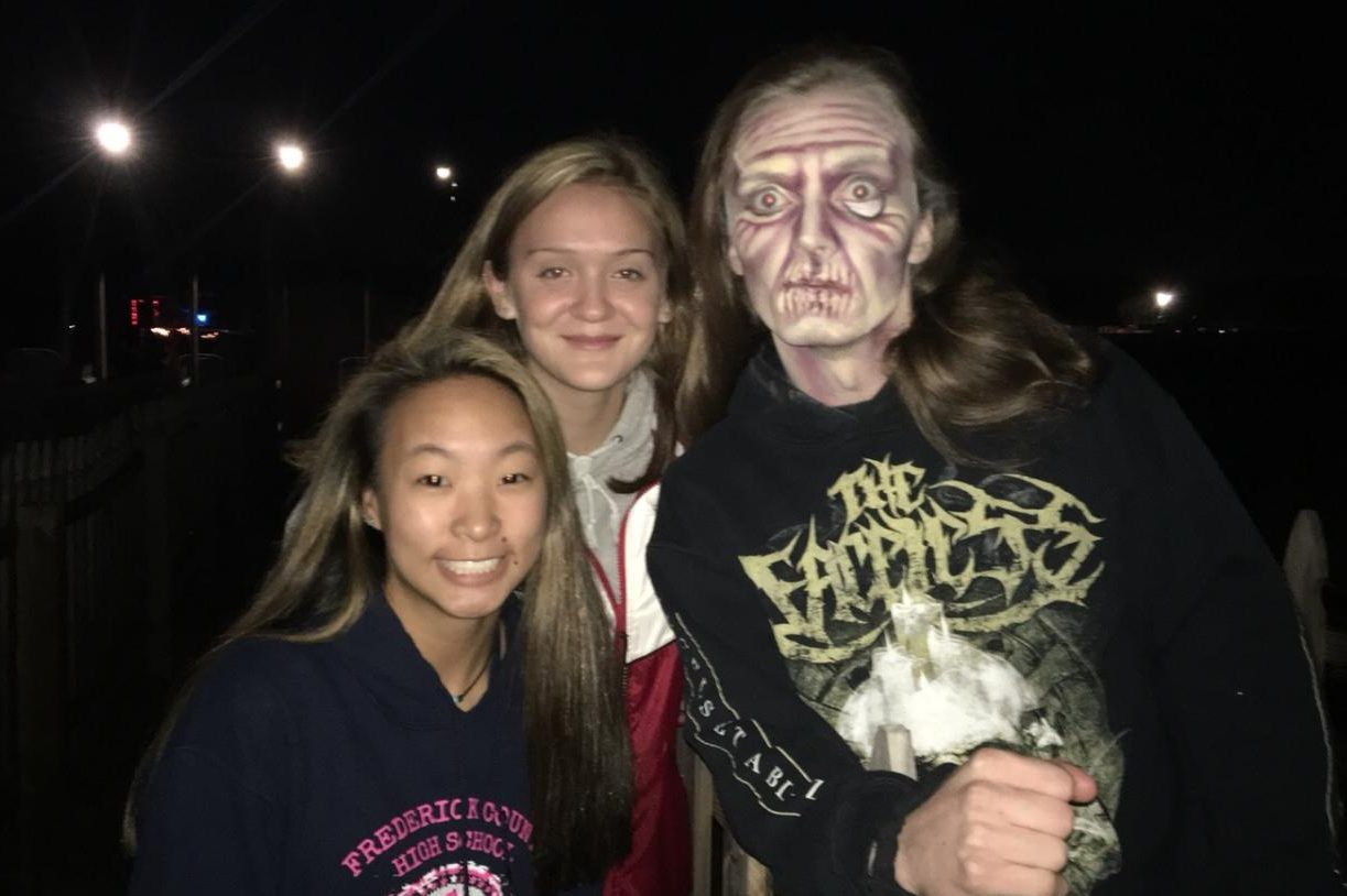 Grace Gaydosh and Julie Walker pose with a Field of Screams actor.