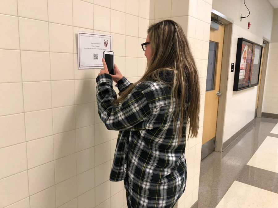 Brianna Archibald tests out new QR codes.