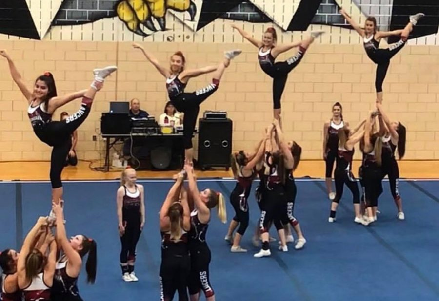 Varsity hits their stunts at the Francis Scott Key competition.